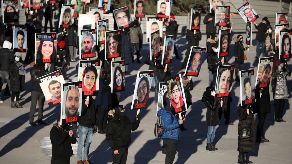 مسيرة لأهالي ضحايا الطائرة الأوكرانية في تورنتو (رويترز)