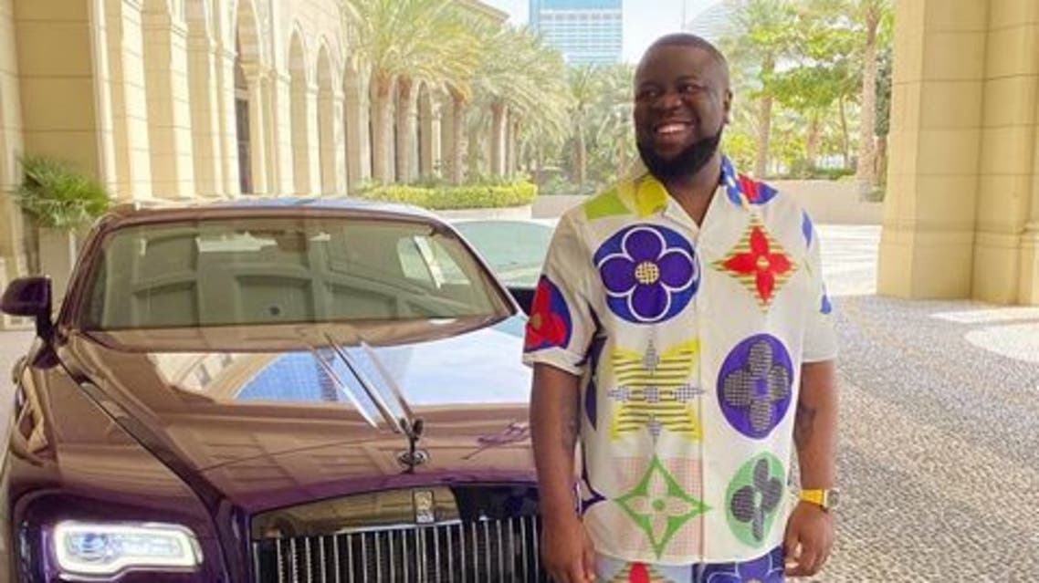 Instagram celebrity 'Ray Hushpuppi' loves to flaunt his wealth on Instagram with pictures of himself alongside luxury cars and jets. (Supplied)