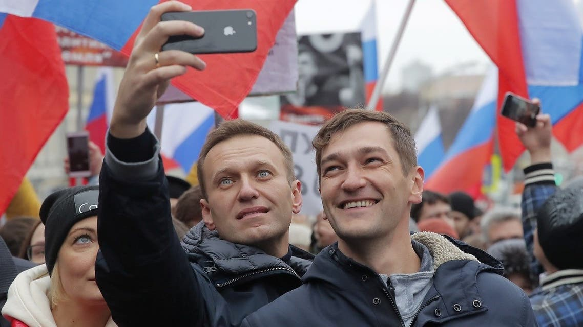 Russian opposition leader Alexei Navalny (L) and his brother Oleg take selfie pictures during a rally in memory of politician Boris Nemtsov, who was assassinated in 2015, in Moscow, Russia, on February 24, 2019. (Reuters)