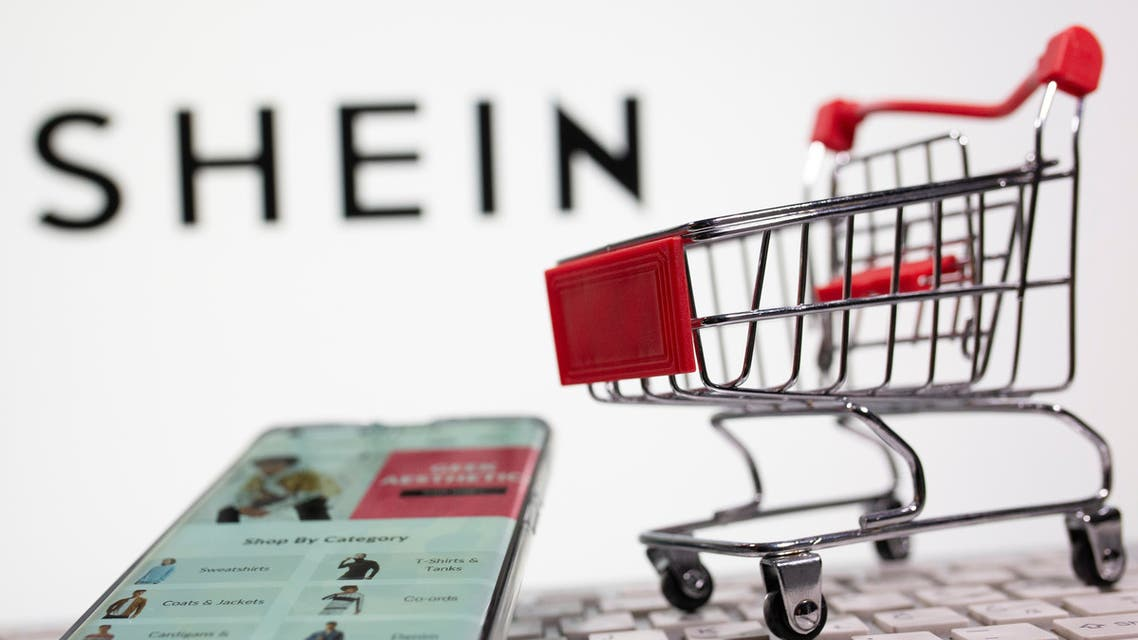 A keyboard and a shopping cart are seen in front of a displayed Shein logo in this illustration picture taken October 13, 2020. (Reuters)