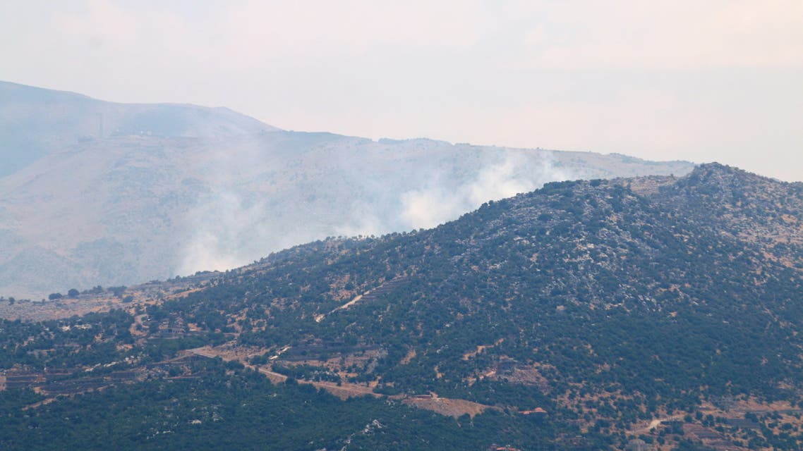 Smoke rises as seen from Ibl al-Saqi village in southern Lebanon, August 6, 2021. (Reuters)