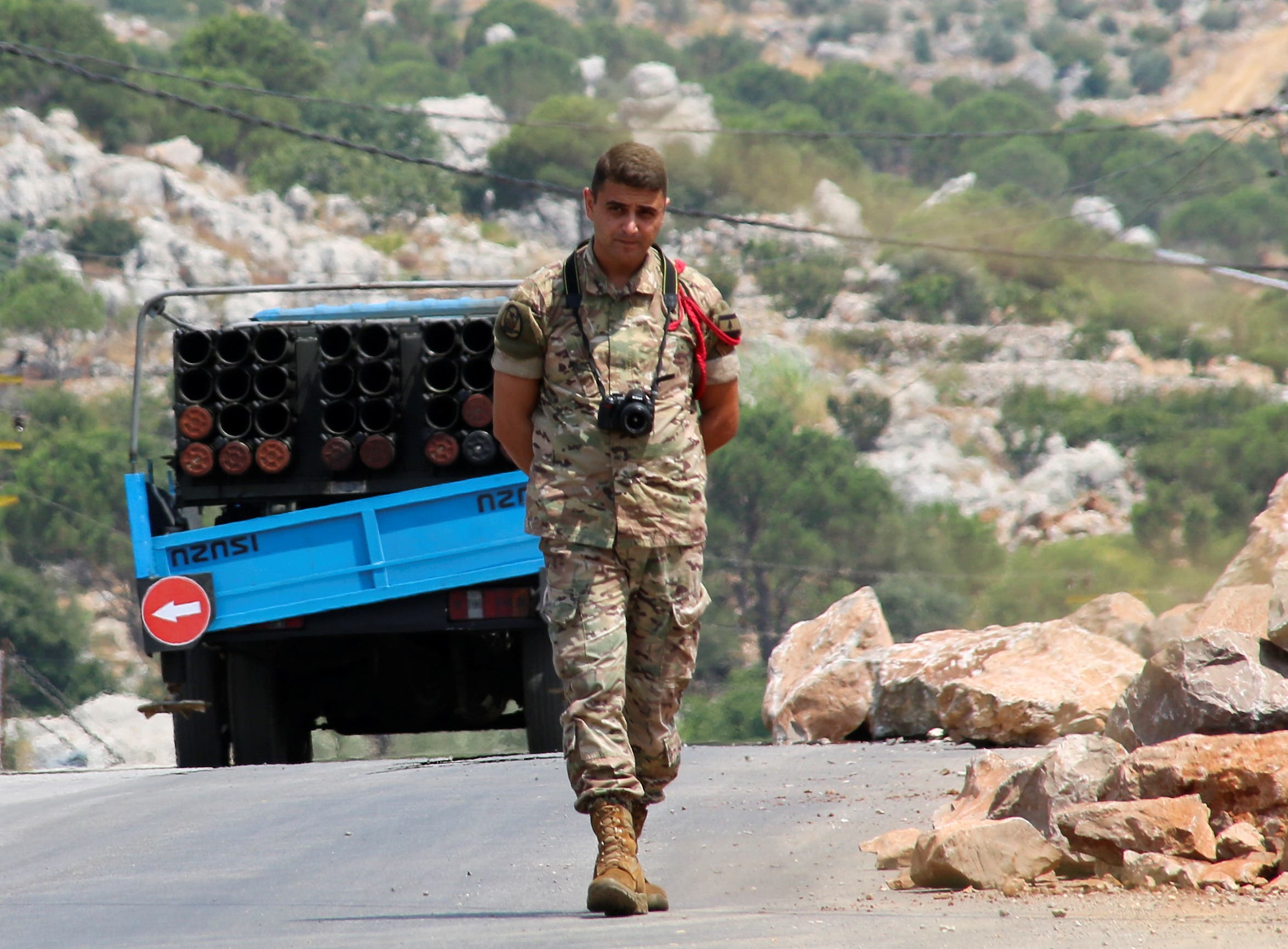 A Lebanese army member walks near a pickup truck with a rocket launcher in Chouaya, Lebanon, August 6, 2021. (File photo: Reuters)