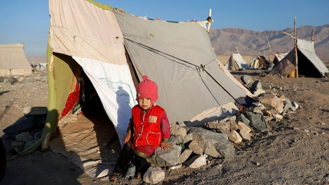 An internally displaced Afghan child sits outside a tent at a refugee camp in Herat province, Afghanistan. (File photo: Reuters)