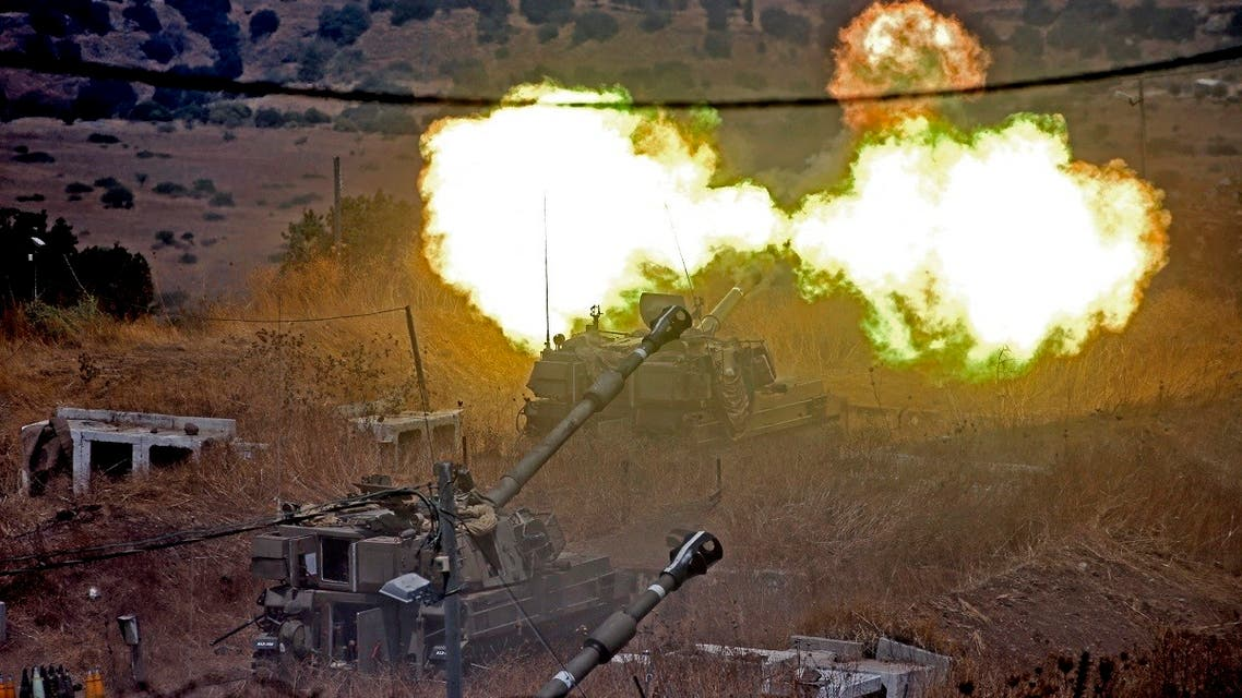Israeli self-propelled howitzers fire towards Lebanon following rocket fire from Lebanon's Hezbollah, on Aug. 6, 2021. (AFP)
