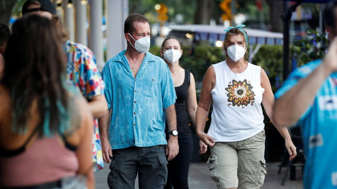 People wearing protective face masks walk in downtown St. Petersburg, amid coronavirus disease (COVID-19) pandemic, in Florida, US, August 6, 2021. (Reuters)