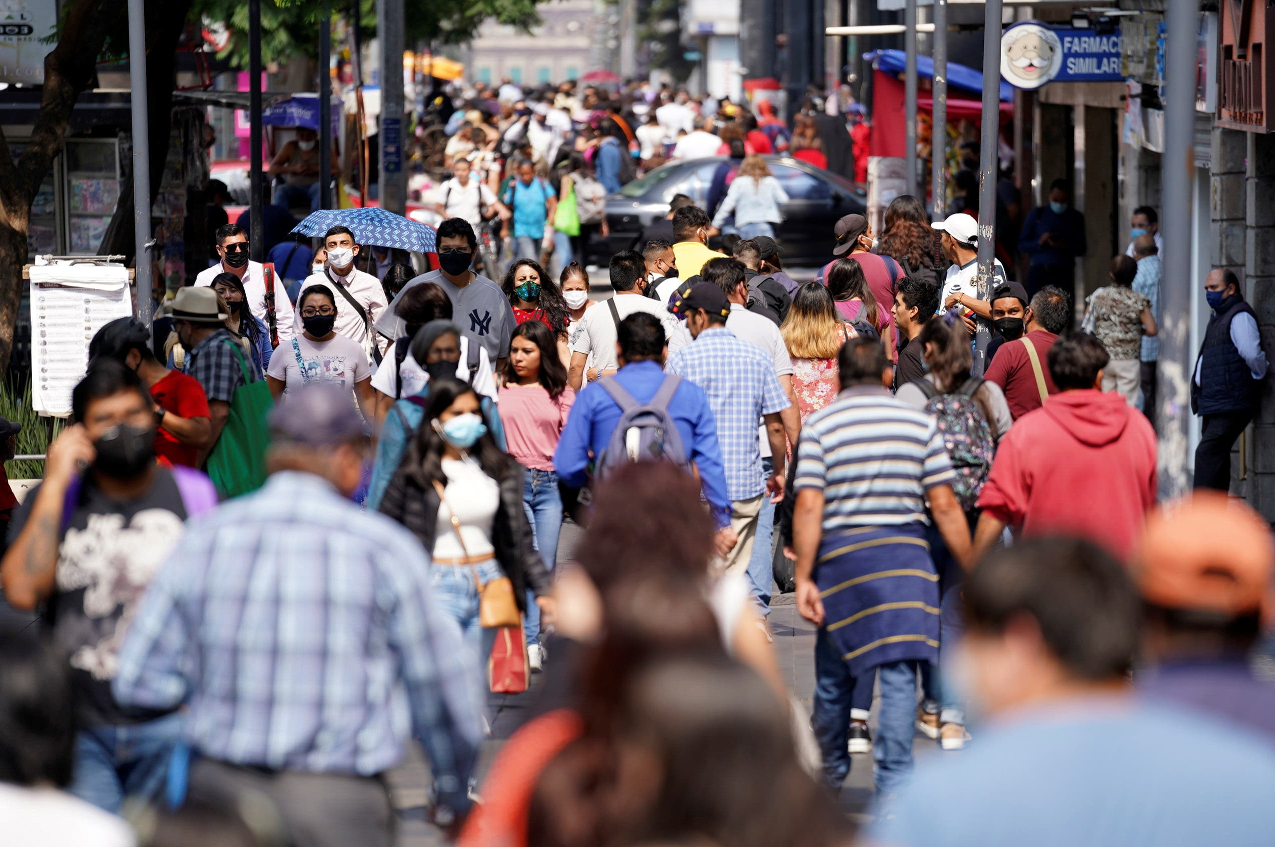 People walk along a crowded street at a commercial area as the coronavirus disease (COVID-19) outbreak continues in Mexico City, Mexico July 23, 2021. (Reuters)