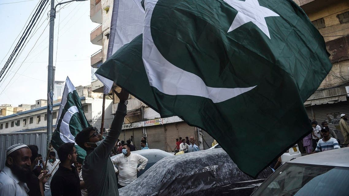People buy Pakistan's national flags at a market in Karachi on August 7, 2021, ahead of the country's 75th Independence Day which marks the end of British colonial rule. (Rizwan Tabassum/AFP)