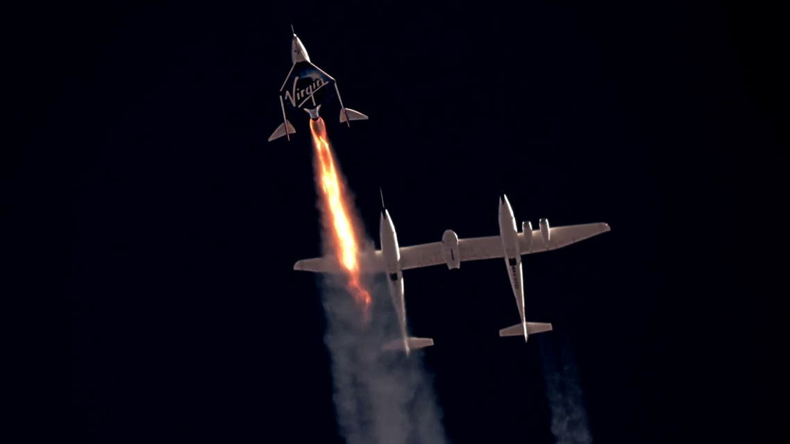Virgin Galactic's passenger rocket plane VSS Unity, carrying Richard Branson and crew, begins its ascent to the edge of space above Spaceport America near Truth or Consequences, New Mexico, U.S. July 11, 2021 in a still image from video. (Reuters)