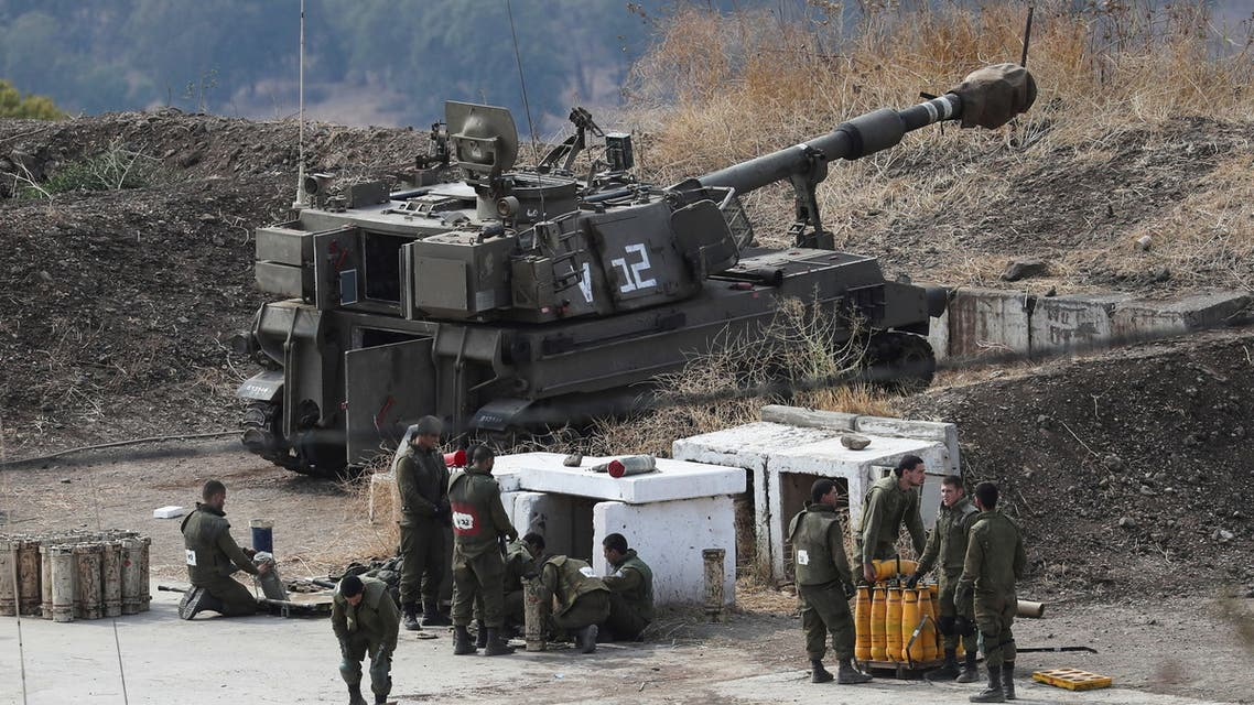 Israeli soldiers stand next to an artillery unit on the Israeli side of the border with Lebanon August 6, 2021. REUTERS/Ammar Awad