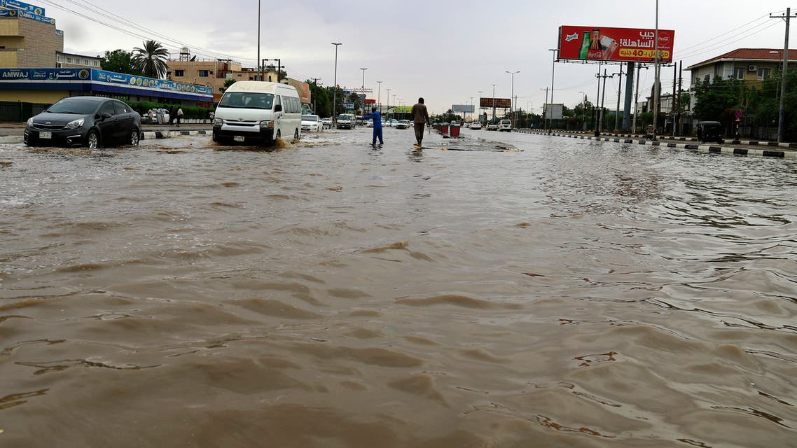 Cars drive along a flooded street in Khartoum after torrential rain fell on the Sudanese capital, almost paralising traffic, on August 8, 2021. Flashfloods due to heavy rains swept through Sudan today, overwhelming the country's already poor drainage systems, and reportedly destroying hundreds of homes in other parts.