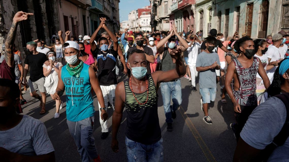 People shout slogans against the government during a protest against and in support of the government, amidst the coronavirus disease (COVID-19) outbreak, in Havana, Cuba July 11, 2021. (Reuters)