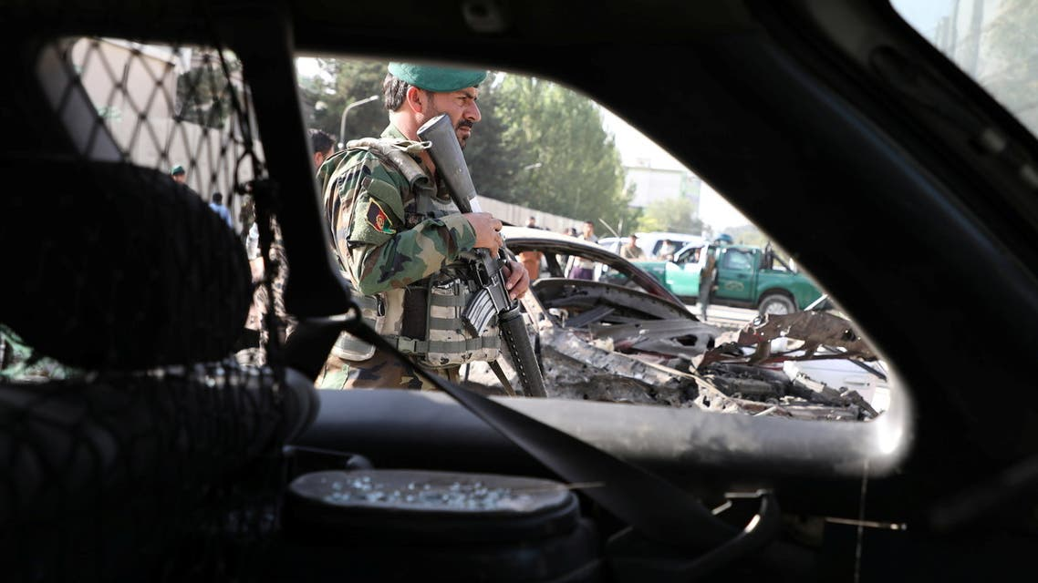 An Afghan National Army (ANA) soldier keeps watch at the site of yesterday's night-time car bomb blast in Kabul, Afghanistan August 4, 2021. REUTERS/Stringer