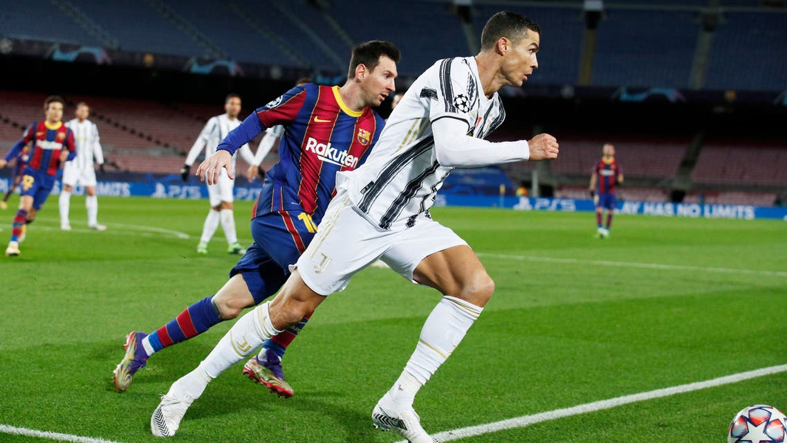 FC Barcelona's Lionel Messi in action with Juventus' Cristiano Ronaldo, Dec. 8, 2020. (Reuters)