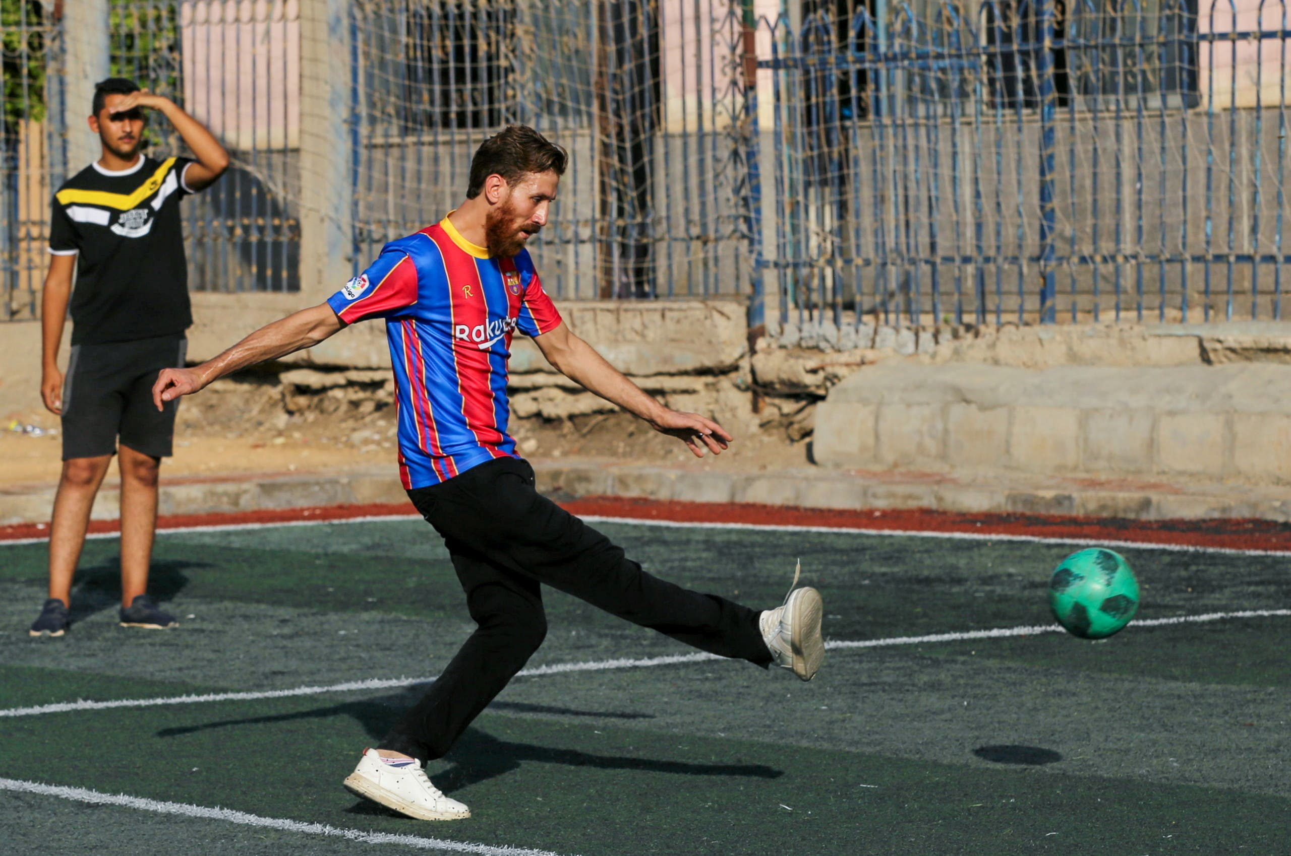 Islam Mohammed Ibrahim Battah, an Egyptian with a resemblance to Barcelona's forward Lionel Messi, attends a training in a club at Sharqia Governorate, north of Cairo, Egypt August 8, 2021. (Reuters)