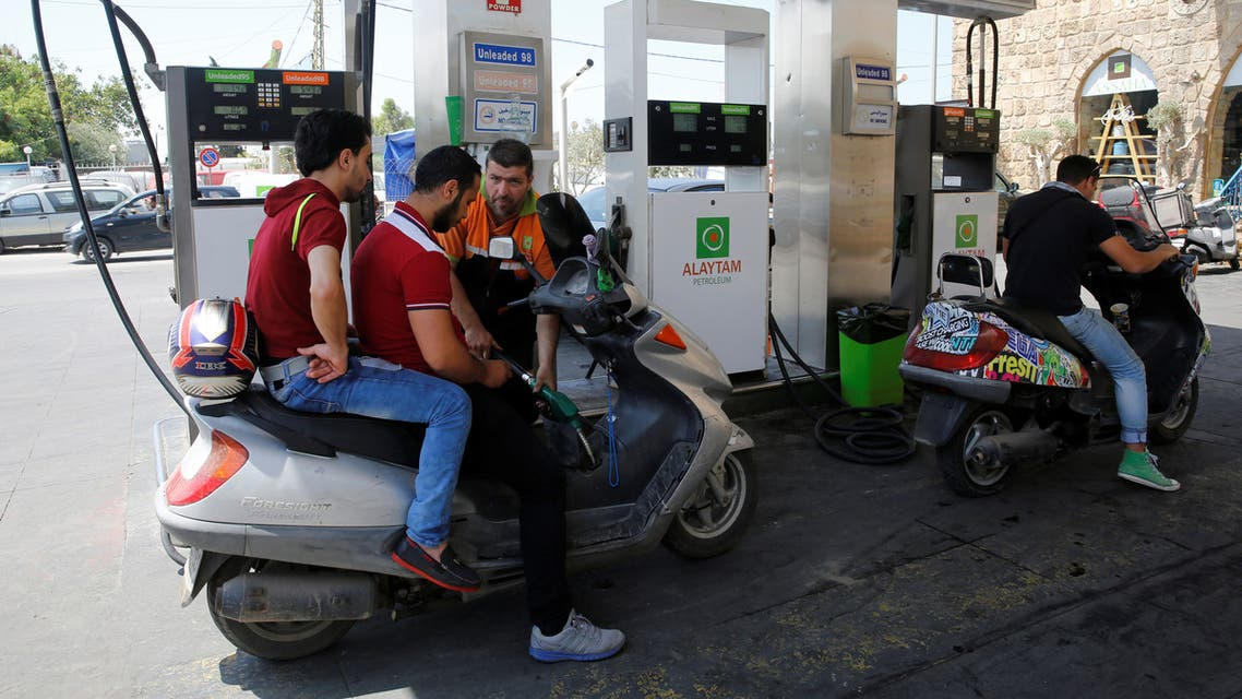Men riding motorbikes refuel at Alaytam petrol station, owned by Mabarrat foundation, in Beirut's southern suburbs, Lebanon May 20, 2016. REUTERS/Jamal Saidi