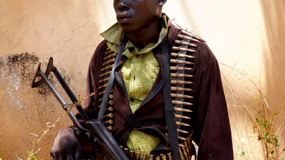 In this file photo taken on February 14, 2019, a member of SPLA-IO stands guard as peace talks take place in Pageri, Imatong State, South Sudan. (Alex McBride/AFP)