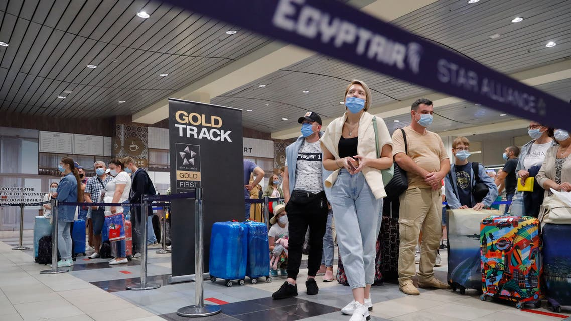Russian tourists gather at the Egyptair check-in desk at the Domodedovo International Airport outside Moscow, Russia, Monday, Aug. 9, 2021. (AP)