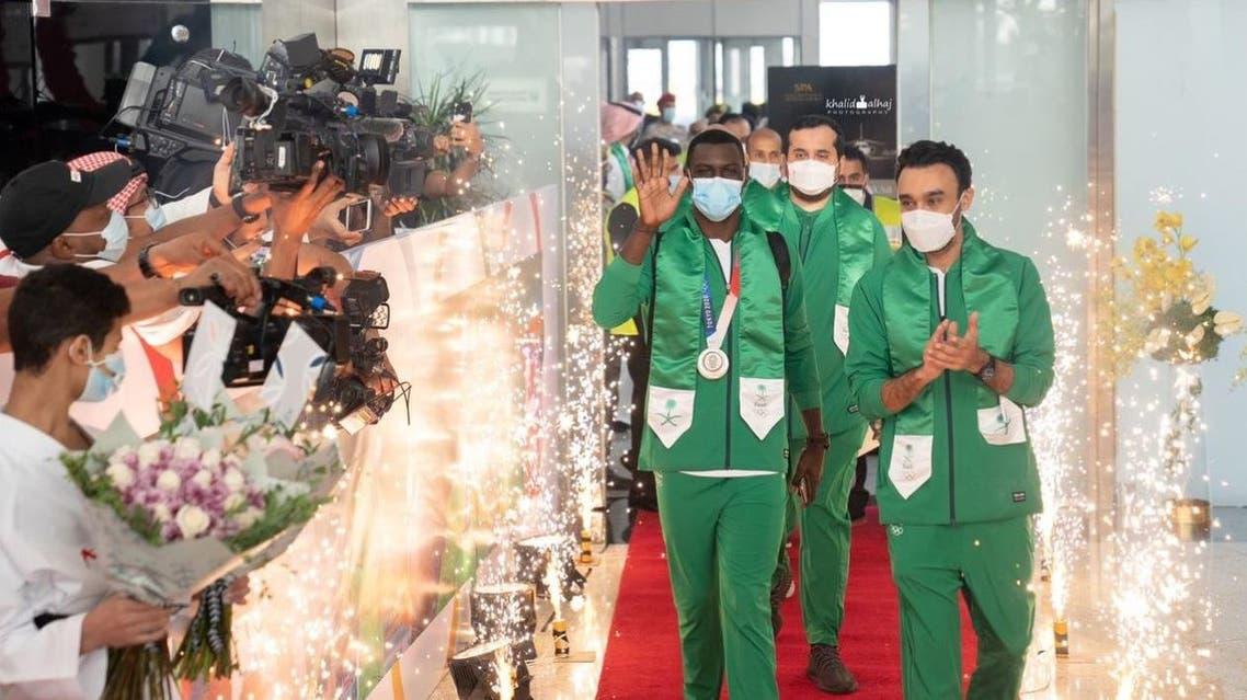 Saudi Arabian Olympic champion and Karate player Tarek Hamedi arrives at Jeddah airport with Saudi Minister of Sports Prince Abdul Aziz bin Turki al-Faisal. (Twitter)