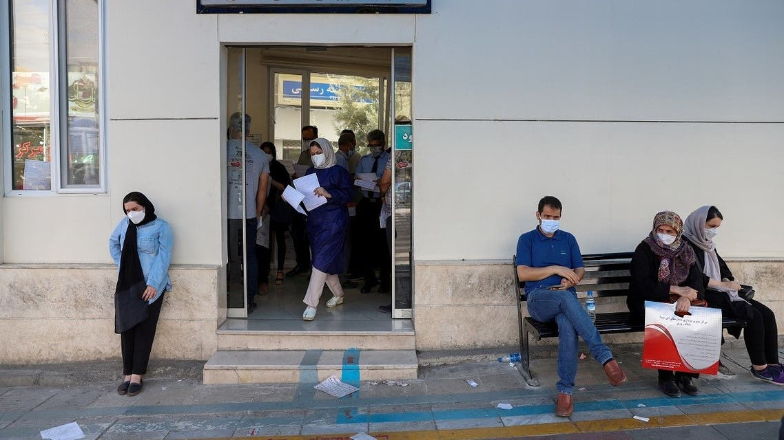 Iranians wait outside of a coronavirus disease testing center as cases spike, in Tehran, Iran, July 28, 2021. (Majid Asgaripour/WANA (West Asia News Agency) via Reuters)