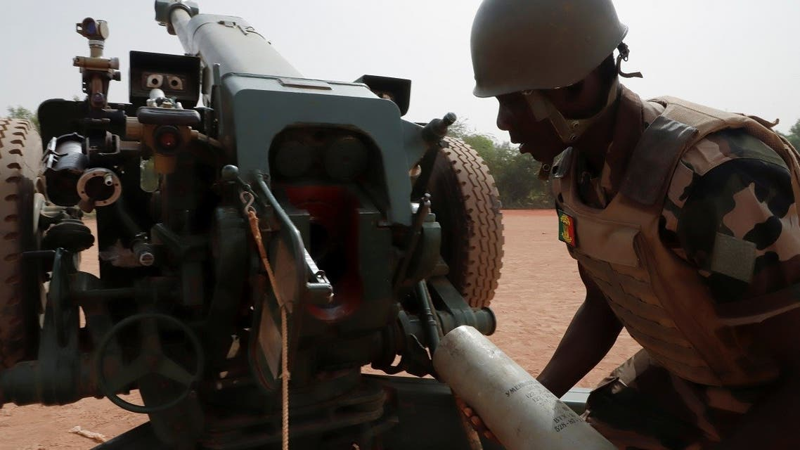 A Malian soldier of the 614th Artillery Battery is pictured during a training session on a D-30 howitzer with the European Union Training Mission (EUTM), to fight militants, in the camp of Sevare, Mopti region, in Mali, on March 23, 2021. (Reuters)