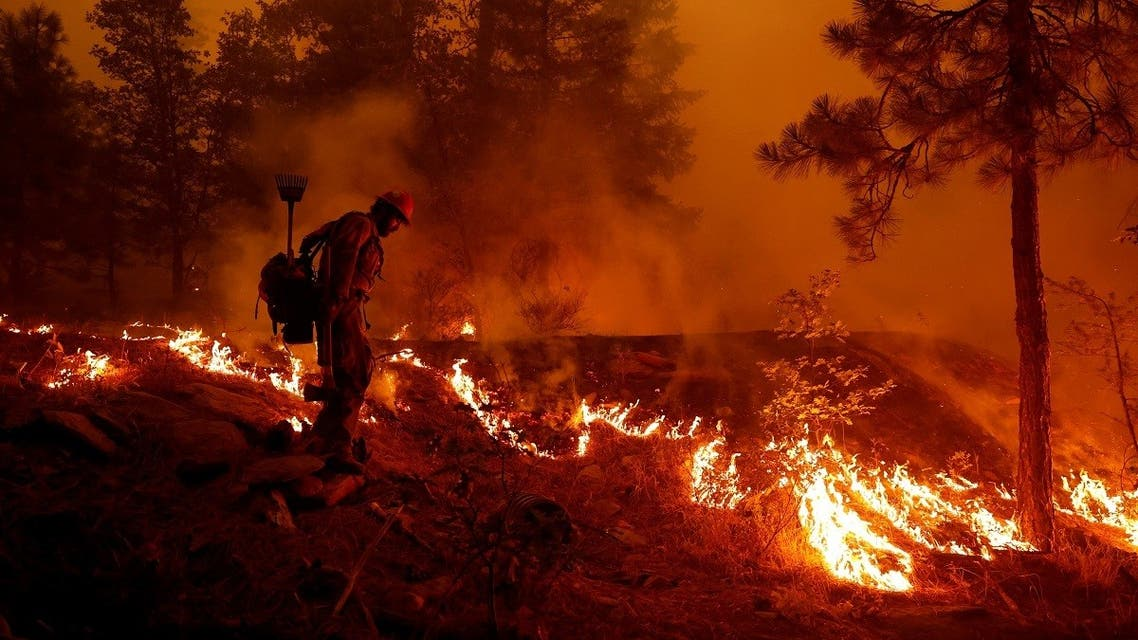 U.S. Forest Service firefighter Ben Foley lights backfires to slow the spread of the Dixie Fire, a wildfire near the town of Greenville, California, U.S. August 6, 2021. (Reuters)