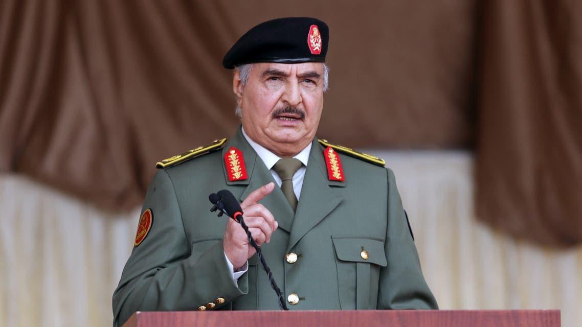 Libyan military commander Khalifa Haftar gestures as he speaks during Independence Day celebrations in Benghazi, Libya December 24, 2020. REUTERS/Esam Omran Al-Fetori