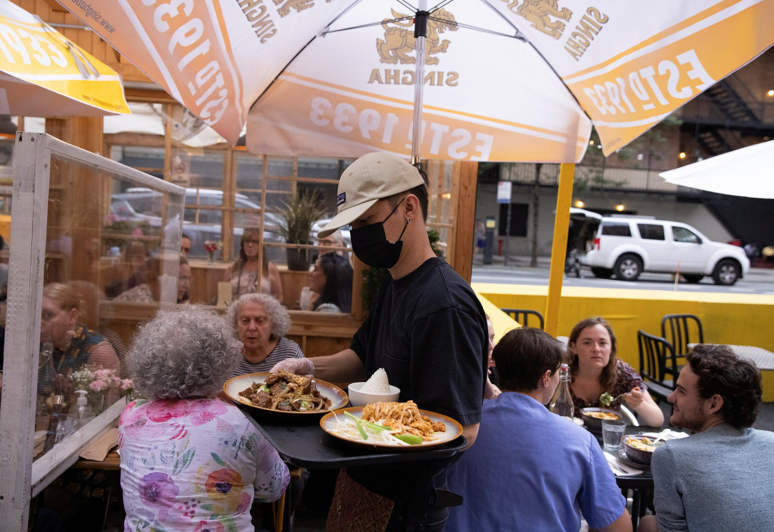 Food is served to guests at a restaurant in Manhattan, after New York City Mayor Bill de Blasio announced that proof of coronavirus disease (COVID-19) vaccination will be required for customers and staff at restaurants, gyms and other indoor businesses, in New York City, U.S., August 3, 2021. (Reuters)