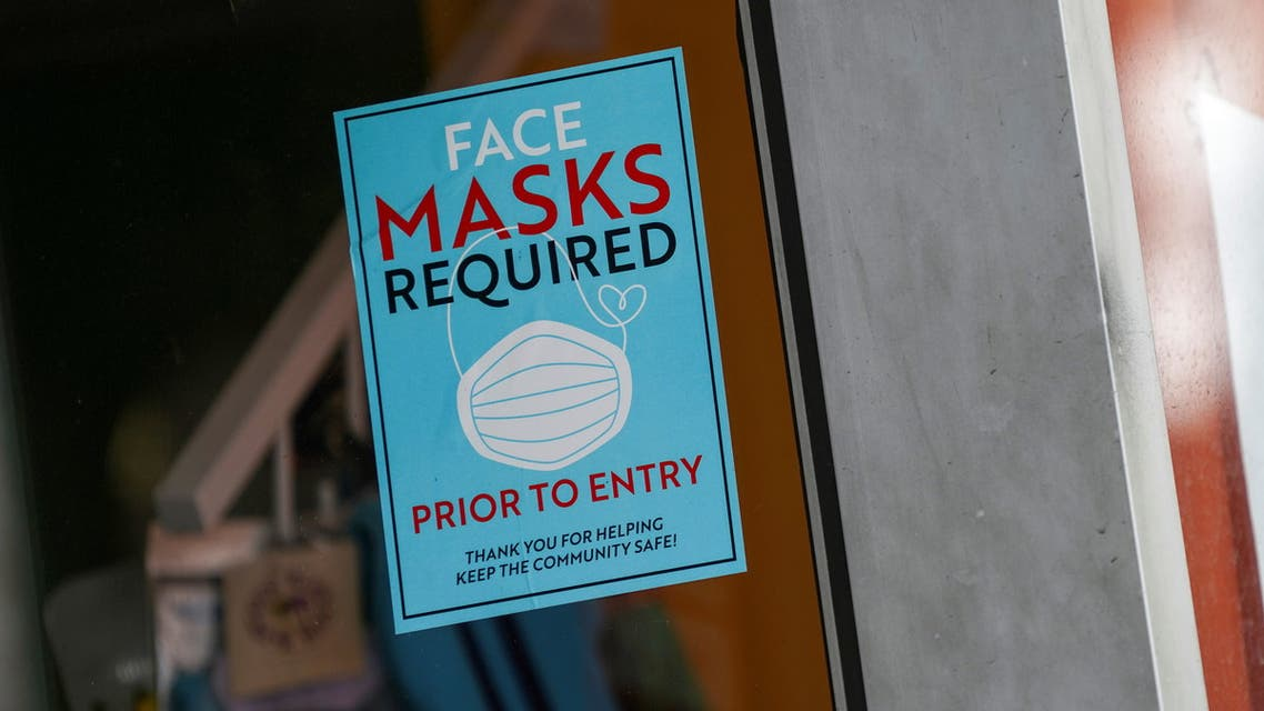A sign at the entry to a beauty salon informs of mask requirement due to COVID-19 measures in New York City, July 27, 2021. (Reuters)