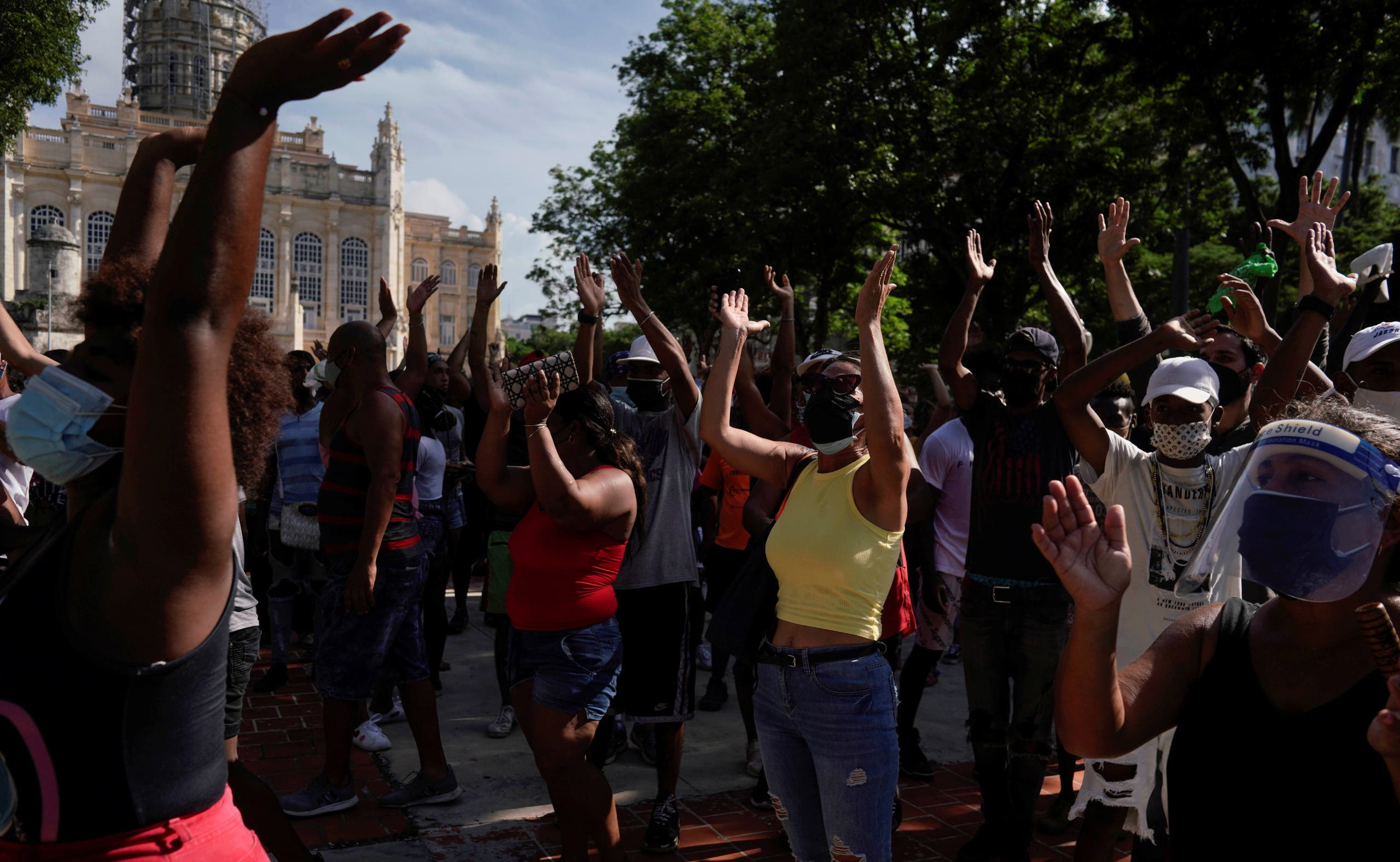 People shout slogans during protests against and in support of the government, amidst the coronavirus disease (COVID-19) outbreak, in Havana, Cuba July 11, 2021. (Reuters)