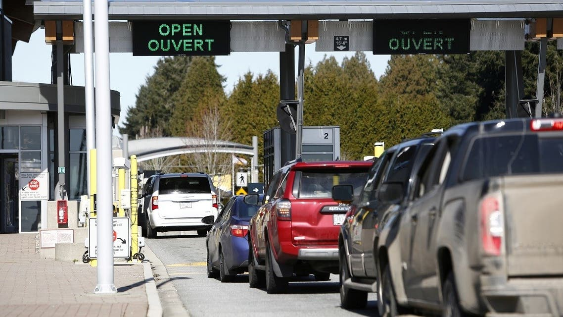 A file photo shows drivers wait to cross through Canadian customs at the Canada-US border near the Peace Arch Provincial Park in Surrey, British Columbia, Canada. Canada March 16, 2020. (Reuters/Jesse Winter)