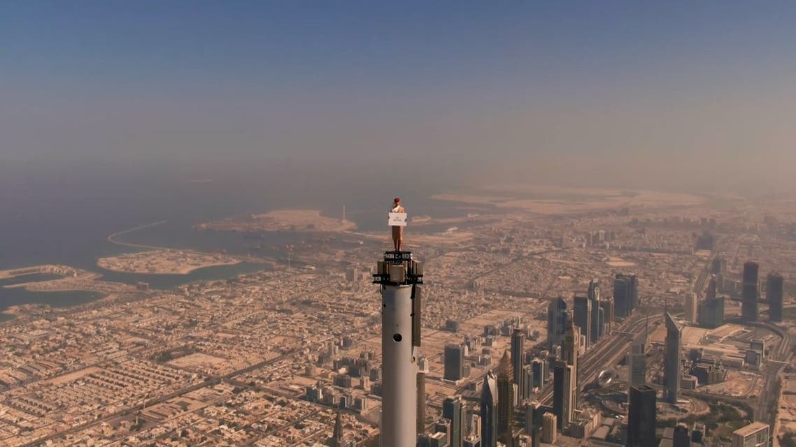 Nicole Lundvik-Smith standing on top of the Burj Khalifa's spire in a viral advertising video for Dubai's Emirates airline. (Dubai Media Office)