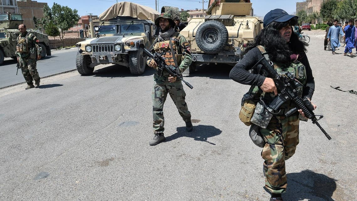 In this picture taken on August 1, 2021, Afghan National Army commando forces walk along a road amid ongoing fighting between Taliban and Afghan security forces in the Enjil district of Herat province. Trained by US Green Berets and equipped with state-of-the-art gear, the Afghan army's special forces are the frontline weapon against the Taliban, but reduced American military support has stretched them to breaking point.