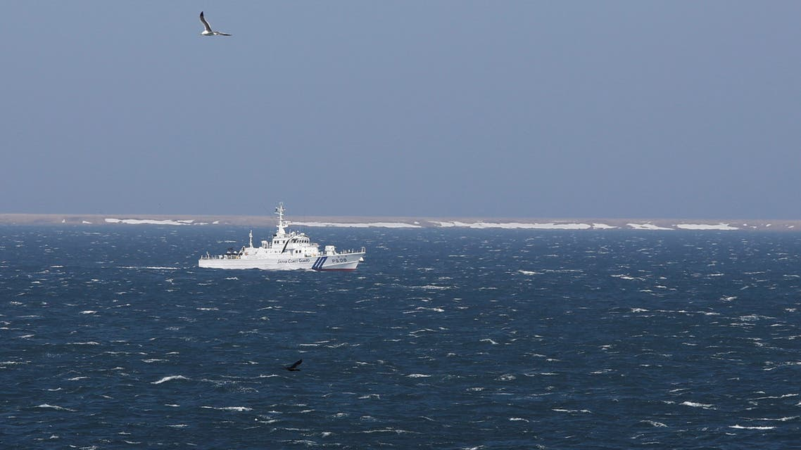 Japan Coast Guard vessel PS08 Kariba sails off Cape Nosappu, easternmost point in Japan, in Nemuro on Hokkaido island, as part of a group of islands known as the Northern Territories in Japan and the Southern Kuriles in Russia can be seen in the background April 14, 2017. (Reuters)
