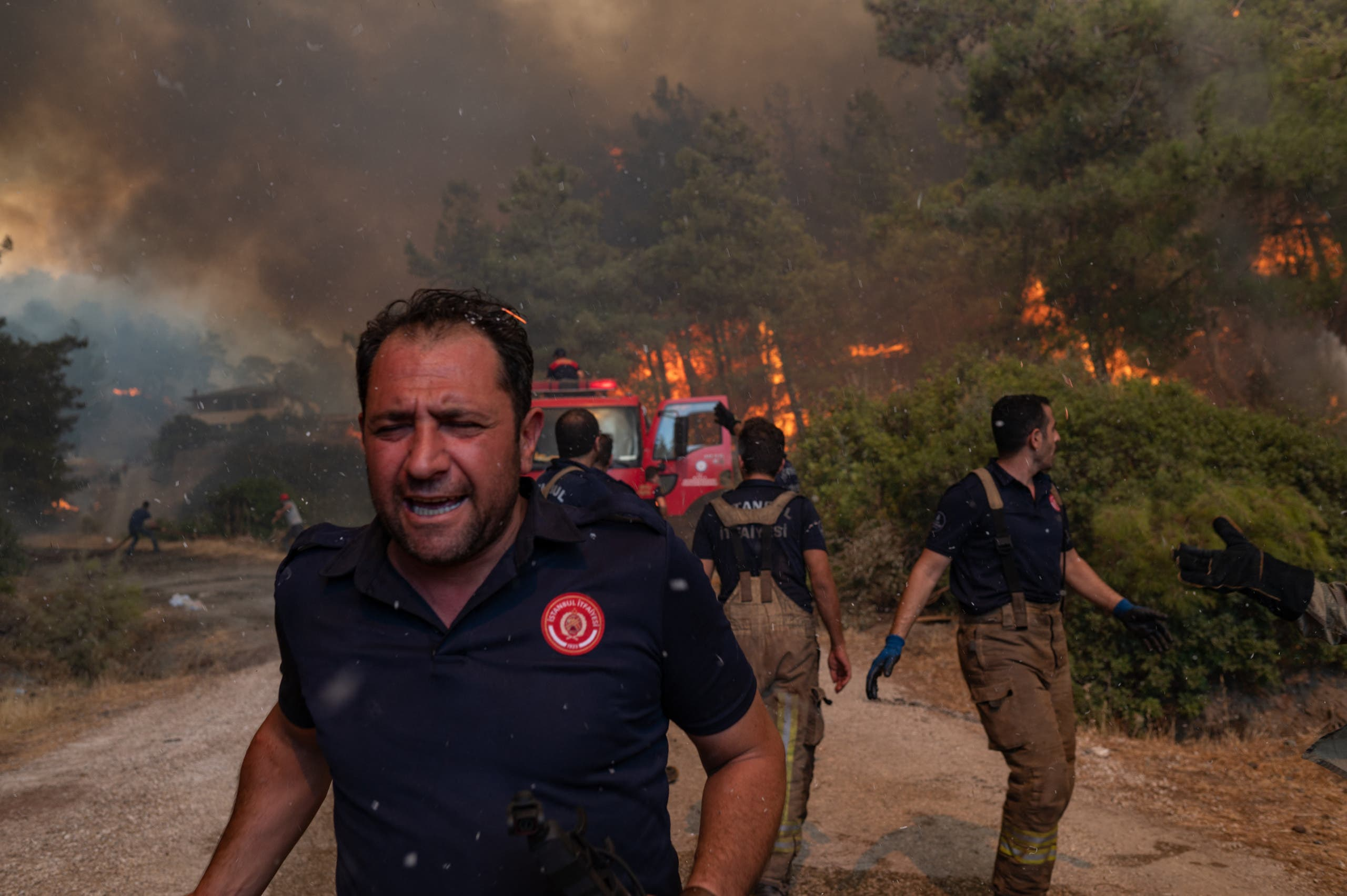 Firefighters battle a wildfire on August 2, 2021 in Mugla, Marmaris district, as the European Union sent help to Turkey and volunteers joined firefighters in battling a week of violent blazes. (AFP)
