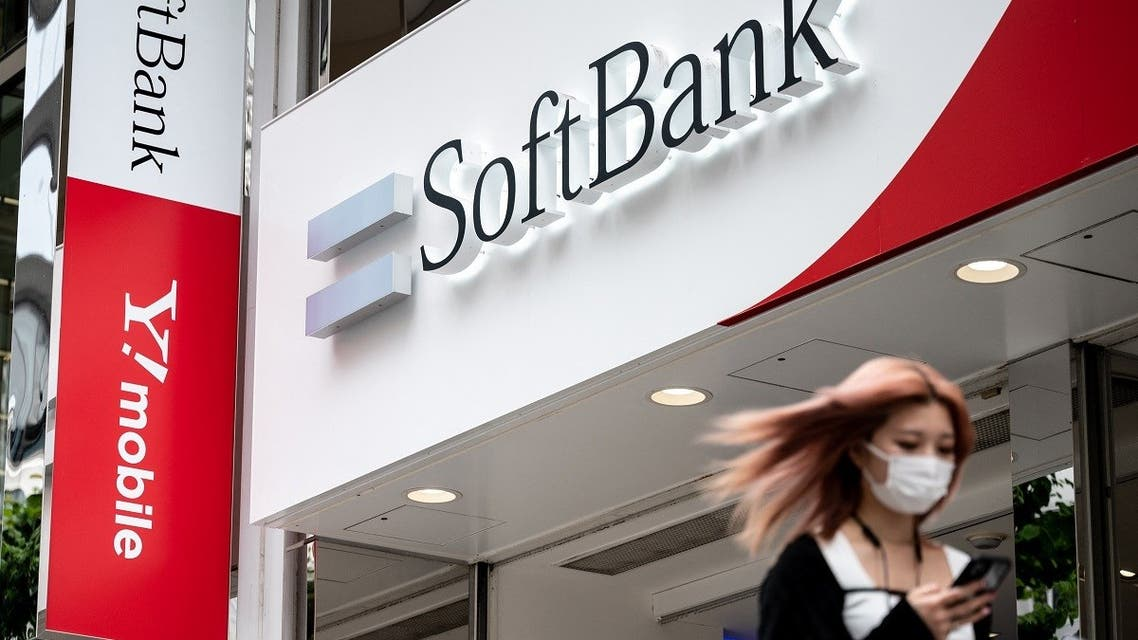A woman walks past a logo of the SoftBank Group in Tokyo. (AFP)
