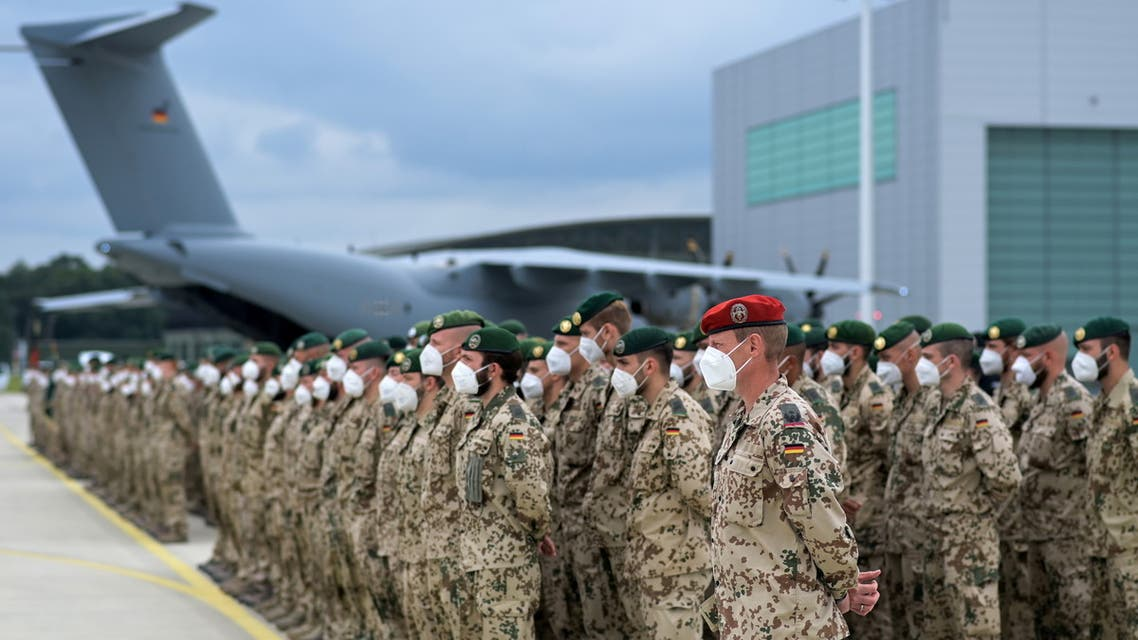 German soldiers line up for the final roll call in front of an German armed forces Bundeswehr Airbus A400M cargo plane after returning from Afghanistan at the airfield in Wunstorf, Germany, June 30, 2021. (File photo: Reuters)