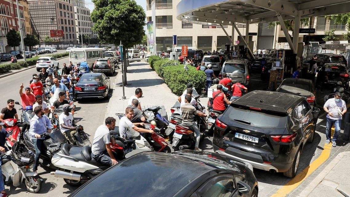 Motorbike and car drivers wait to get fuel at a gas station in Beirut, Lebanon June 29, 2021. (Reuters)