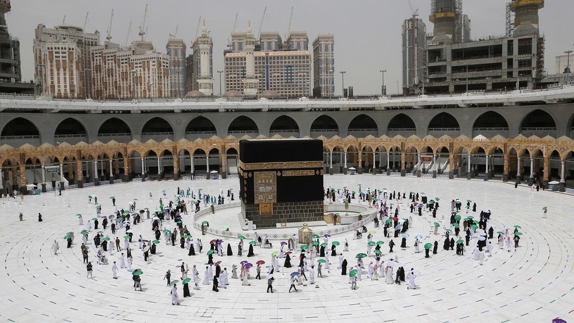 Pilgrims keeping social distance and wearing face masks, perform farewell Tawaf around the holy Kaaba in the Grand Mosque, after completing their extended Haj, Haj Al Kabeer, during the annual Haj pilgrimage in the holy city of Mecca, Saudi Arabia. (Reuters)