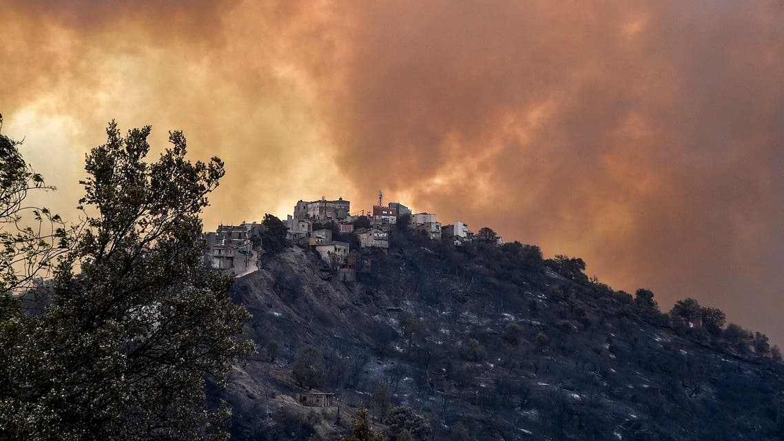 Smoke rises from a wildfire in the forested hills of the Kabylie region, east of the capital Algiers, on August 10, 2021. (Ryad Kramdi/AFP)