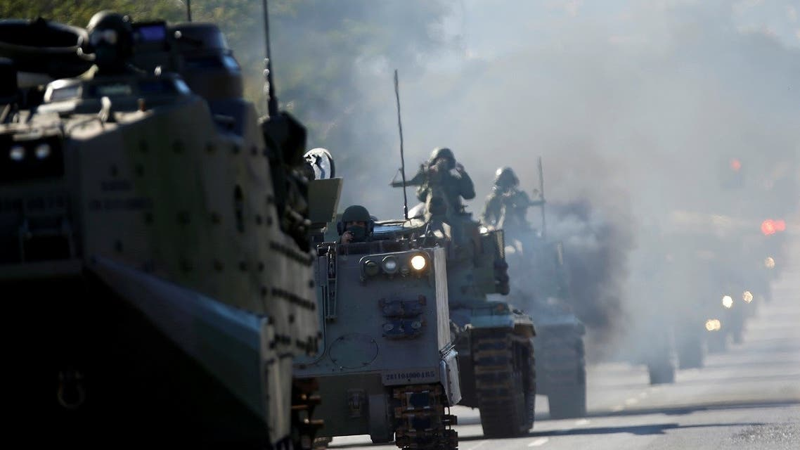 Brazilian Navy tanks pass in front of the Planalto presidential palace during a military parade in Brasilia, Brazil August 10, 2021. (Reuters/Adriano Machado)
