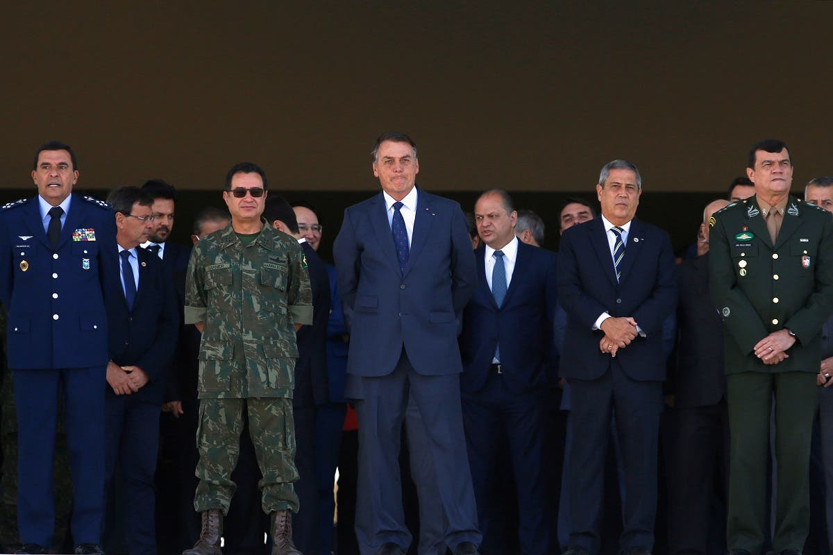 Brazil's President Jair Bolsonaro looks on before Brazilian Navy tanks pass in front of the Planalto presidential palace during a military parade in Brasilia, Brazil August 10, 2021. (Reuters/Adriano Machado)