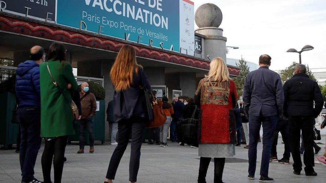 People queue outside a mass vaccination center in Paris, as part of the coronavirus disease (COVID-19) vaccination campaign in France, May 12, 2021. (Reuters/Sarah Meyssonnier)