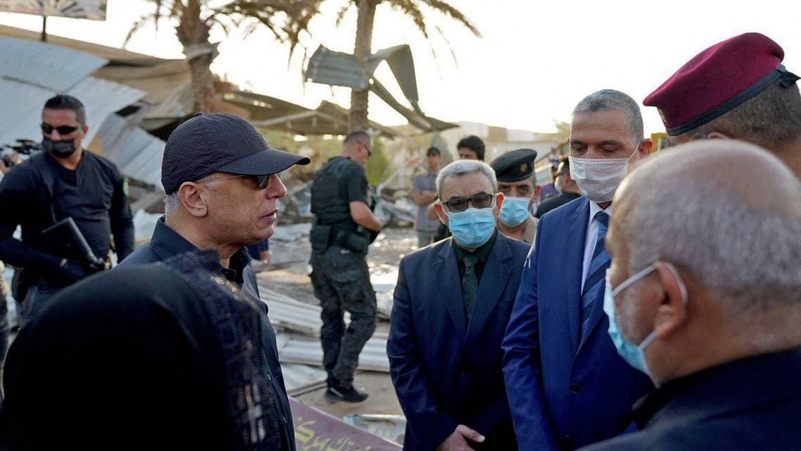 Iraqi Prime Minister al-Kadhemi (L) during a tour in the holy Shia city of Karbala, south of the capital Baghdad, on August 11, 2021. (Iraq's Prime Minister's Press Office/AFP)