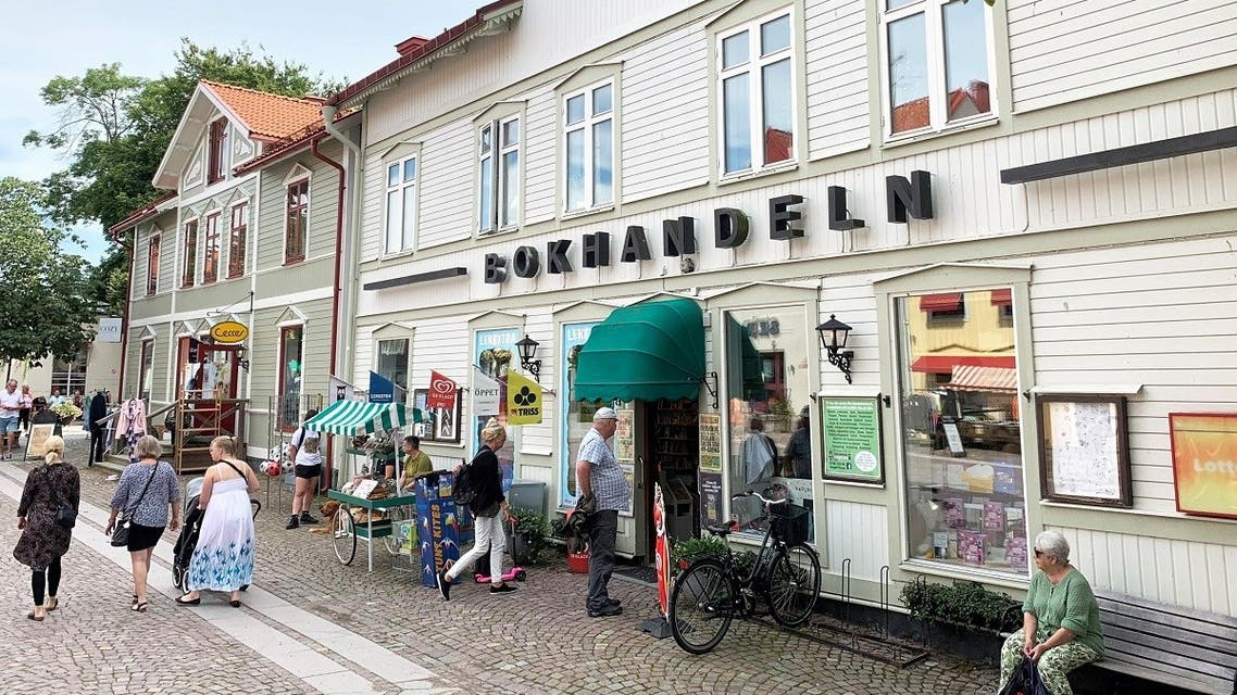 People check out what's on display outside a local bookstore in east-coast small-town Trosa, Sweden August 11, 2021. (Reuters/Anna Ringstrom)