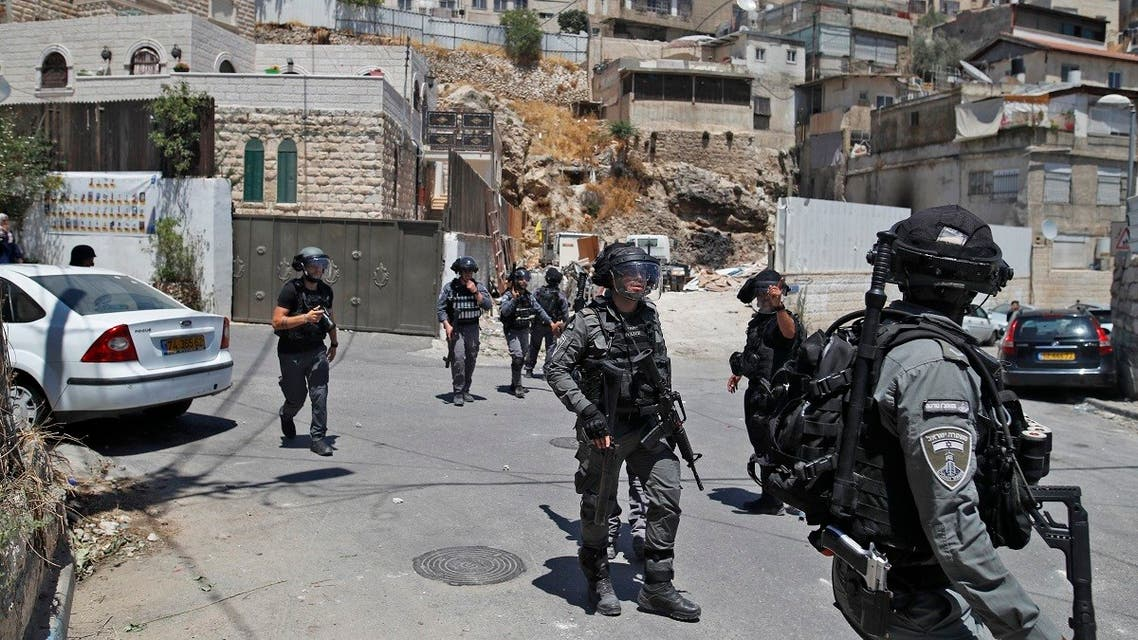 Israeli security forces gather during clashes with Palestinians following Friday noon prayers on July 2, 2021 in the predominantly Arab neighborhood of Silwan, just outside the Old City in Israeli-annexed east Jerusalem. (Ahmad Gharabli/AFP)