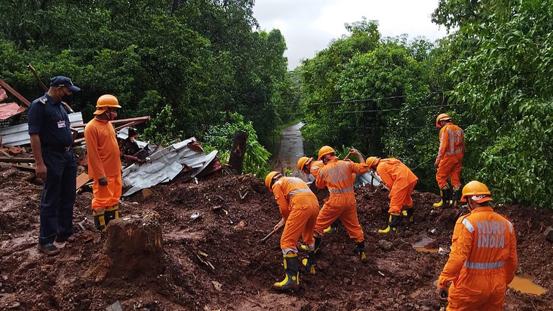 In this handout photo taken on July 25, 2021 and released by India's National Disaster Response Force (NDRF), shows NDRF personnel conducting search and rescue operations at the site of a landslide after heavy monsoon rains at Kumbharwadi village in Chiplun district of Maharashtra. (File photo: AFP)