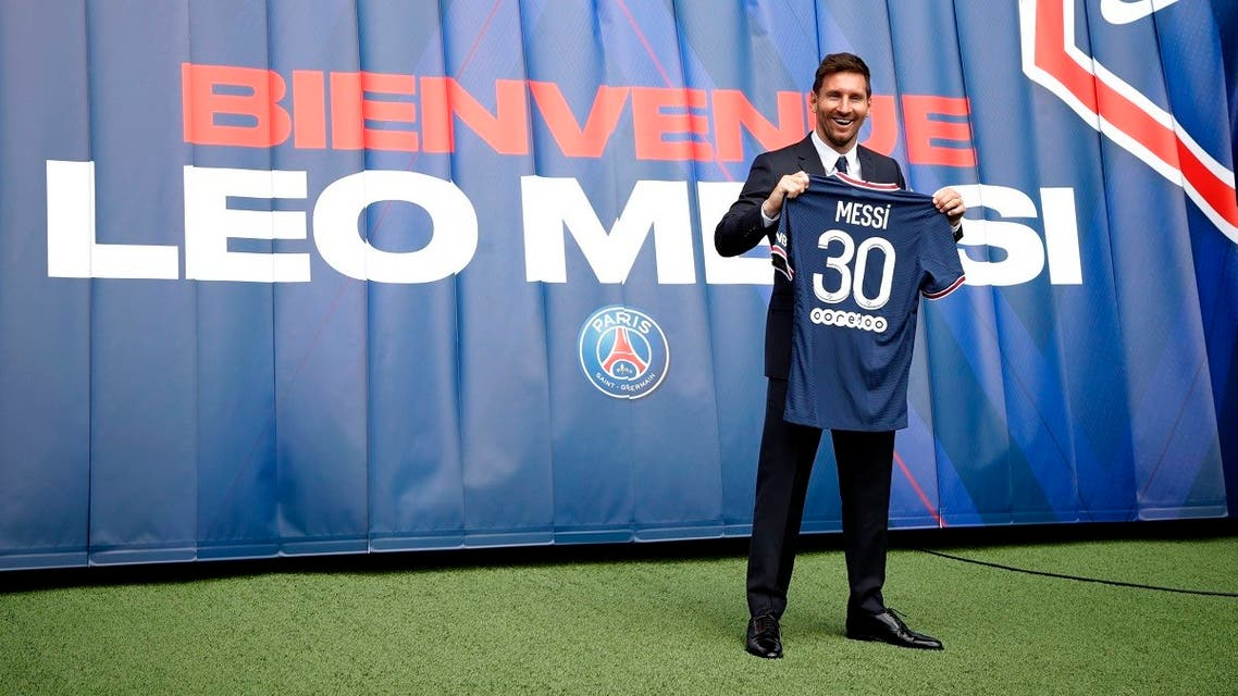 Lionel Messi after signing for Paris St Germain poses with a shirt on the pitch after the press conference, Paris, France, August 11, 2021. (Reuters/Sarah Meyssonnier)