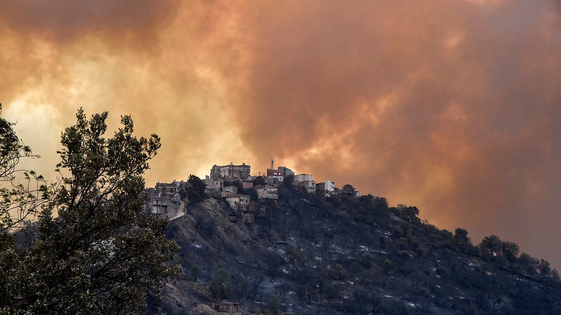 Smoke rises from a wildfire in the forested hills of the Kabylie region, east of the capital Algiers, on August 10, 2021.