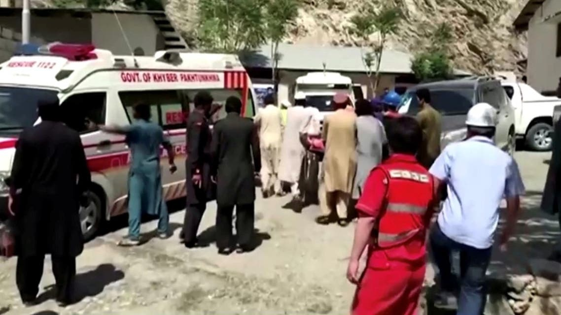 People wheel a gurney towards an ambulance outside a hospital in Dasu, after a bus with Chinese nationals on board plunged into a ravine in Upper Kohistan following a blast, Pakistan, on July 14, 2021. (Reuters)