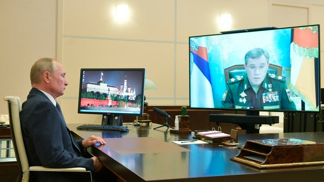 Russian President Vladimir Putin listens to General Staff chief Valery Gerasimov at the Novo-Ogaryovo residence outside Moscow, Russia, 0n Oct. 7, 2020.  The Russian military has reported a successful test launch of the new Zircon hypersonic cruise missile, giving the news to Putin on his 68th birthday. (AP)